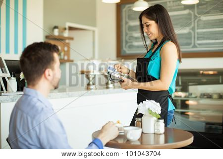 Waitress Swiping A Credit Card