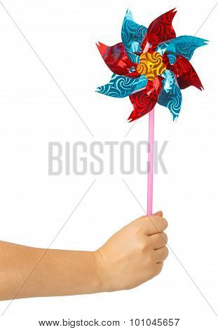 Colorful Children's Pinwheel In Female Hand