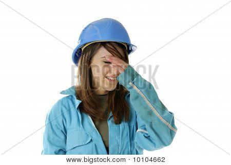 Young Female Apprentice Having A Headache