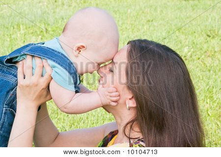 Mom Is Laughing And Kissing Her Baby