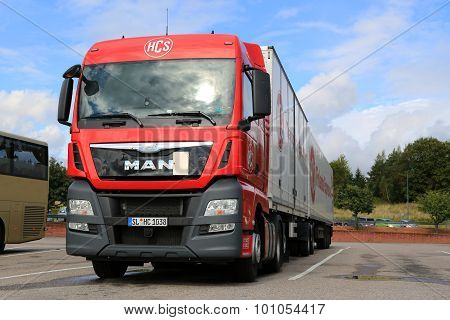 Red MAN TGX 26.480 Truck And Full Trailer Parked