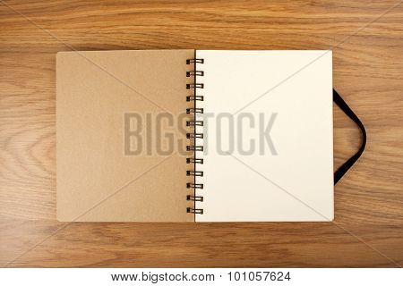 Blank Spiral Notebook On A Wooden Background With Clipping Path.