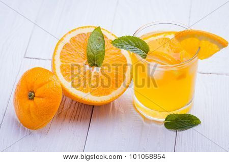 orange alcohol cocktail on a wooden table.