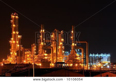 scenic of petrochemical oil refinery plant shines at night closeup