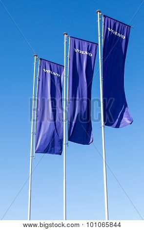 Volvo Dealership Flags Over Blue Sky