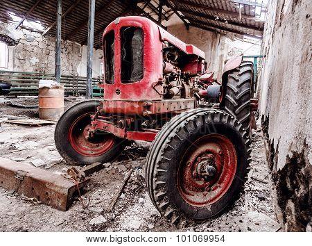 Old, Broken Tractor Indoors