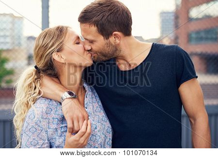Amorous Young Couple Enjoy A Romantic Kiss
