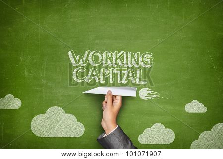 Working capital concept on blackboard with paper plane