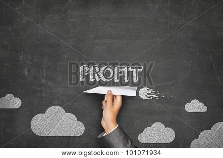 Profit concept on blackboard with paper plane