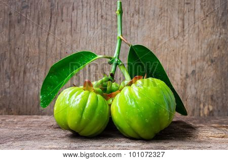 Still Life With Fresh Garcinia Cambogia On Wooden Background (thai Herb)