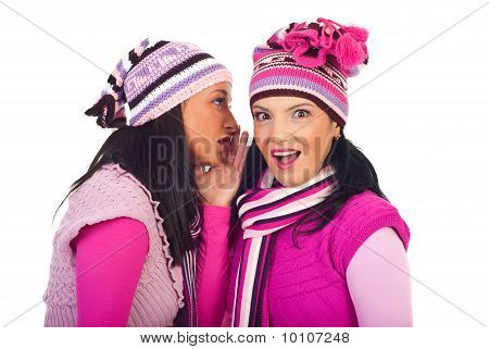 Woman Telling Secret To Her Surprised Friend