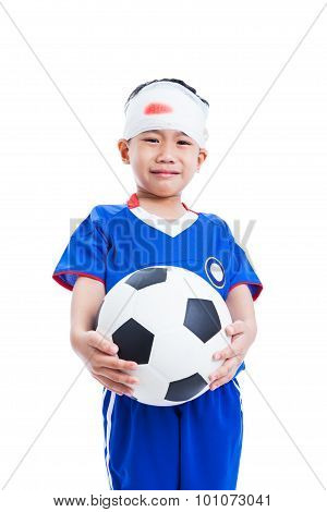 Asian Child With Trauma Of The Head Holding A Football And Crying Isolated On White