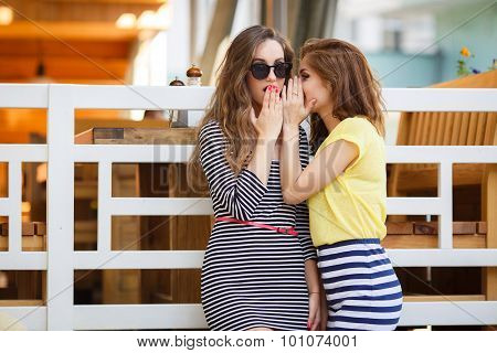 Two young girls share secrets