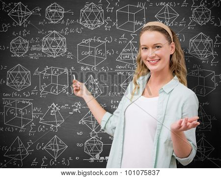 Teacher explaining maths in blackboard against black background