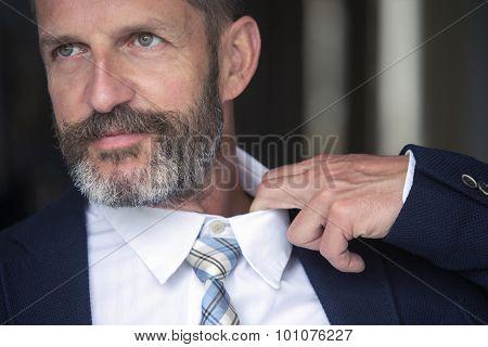 Closeup Of Man Loosens His Shirt