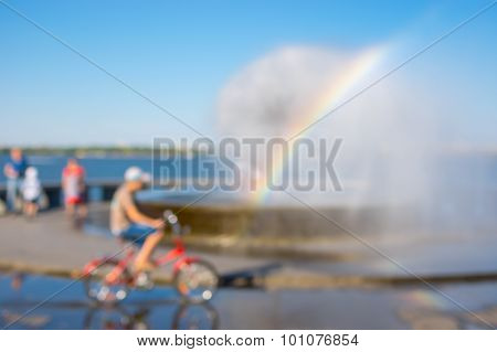Blurry natural background - summer landscape with scene around fountain