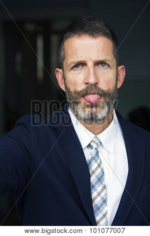 Businessman Taking A Selfie And Pulling Out His Tongue