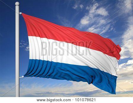 Waving flag of Netherlands on flagpole, on blue sky background.