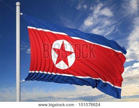 Waving flag of North Korea on flagpole, on blue sky background.