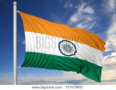 Waving flag of India on flagpole, on blue sky background.