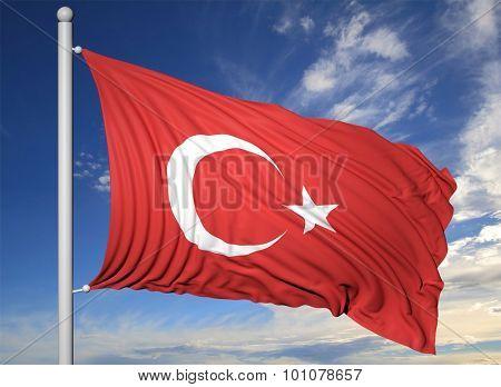 Waving flag of Turkey on flagpole, on blue sky background.