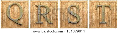 Group of wooden letters Q R S T framed, isolated on white