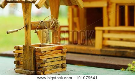 Model of wooden draw-well and house