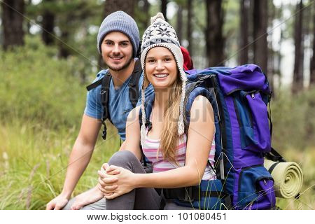 Portrait of a young smiling hiker couple in the nature