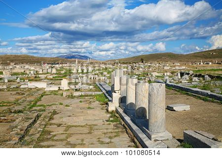 Ancient ruins on the island of Delos, of the coast of Greece. The archaeological site of Delos is on UNESCO World Heritage List since 1990.