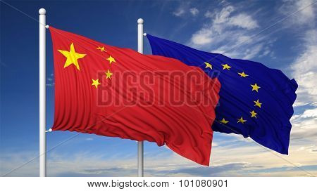 Waving flags of China and EU on flagpole, on blue sky background.
