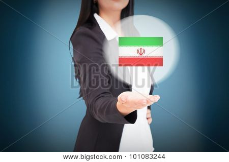 Pretty businesswoman presenting with hand against blue background