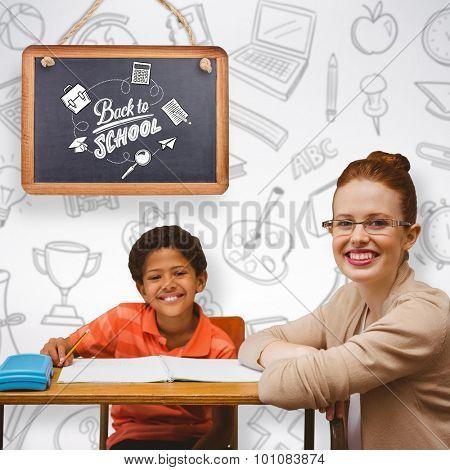 Teacher helping pupil against grey background