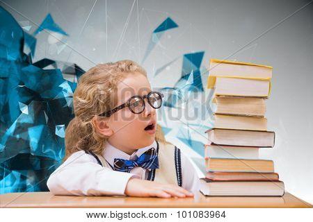 Surprise pupil looking at books against angular design