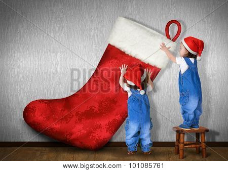 Funny Little Twins Dressed Santa Hat, Hangs Big Christmas Stocking For Gifts, Xmas Concept