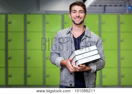 Student smiling at camera in library against locker room