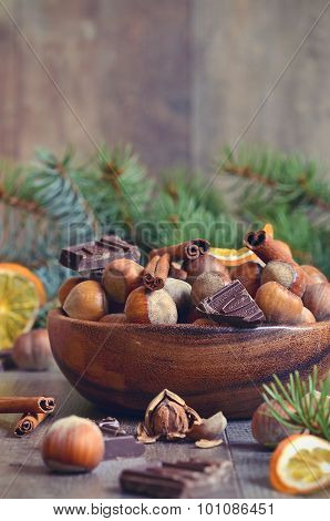 Hazelnuts And Christmas Spices In A Wooden Bowl.