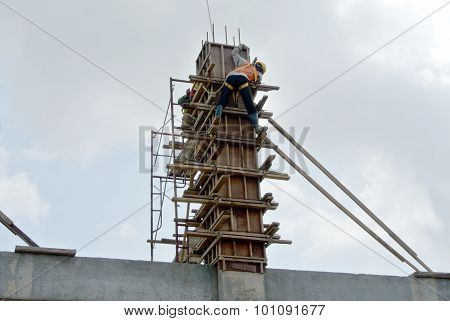 Group of construction worker fabricating column formwork
