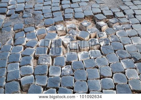 Damaged Cobblestone Road Pavement With Sand