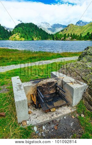 Barbecue Area Close To An Alpine Lake