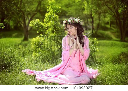 Beauty Romantic Girl Outdoors. Beautiful Teenage Model Girl With Flower Chaplet On The Grass At Gree