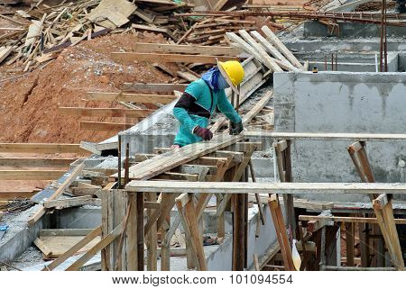 A construction worker fabricating beam formwork