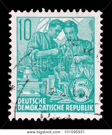 GDR - CIRCA 1953: A stamp printed in GDR, shows Two workers, series Five year plan, circa 1953