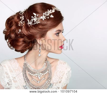 Wedding Hairstyle. Beautiful Fashion Bride Girl Model Portrait. Luxury Jewelry.  Attractive Young Wo