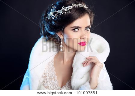 Makeup. Beauty Winter Portrait Of Fashion Girl  In White Fur Coat. Hairstyle. Elegant Woman Isolated