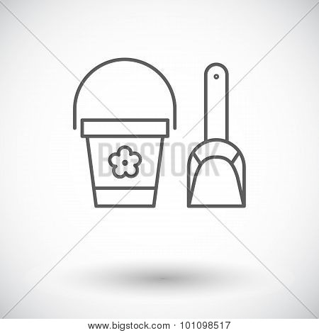 Pail and shovel icon.