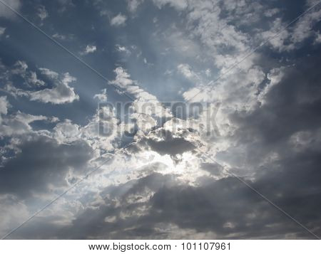 Sky With Giants Cumulonimbus Clouds And Sun Rays Through