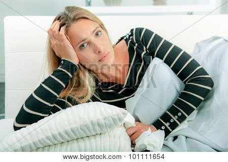 Woman at home with the flu