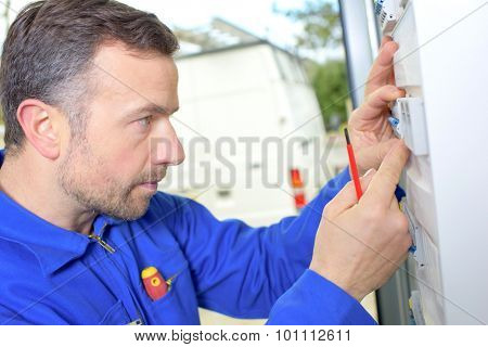 Handyman working on a fusebox