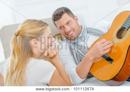 Impressing a girl by playing the guitar