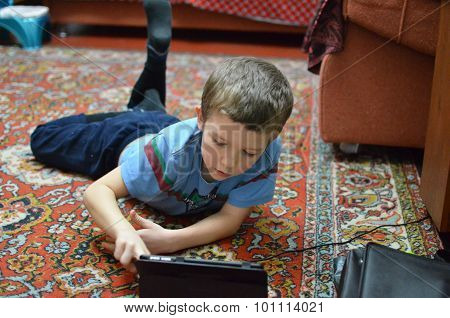 A Boy Plays The Plane-table